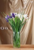 Beautiful irises on table, close up — Stock Photo