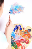 Artist paints picture close-up — 图库照片