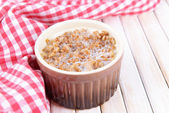 Boiled buckwheat with milk in bowl on table close-up — Stock Photo