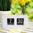 Digital alarm clock on table, on nature background — Stock Photo #44411809