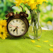 Digital alarm clock on table, on nature background — Stock Photo #44411829