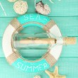 Lifebuoy and sea shells on wooden background — Stock Photo #44413799