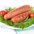 Grilled sausage on plate on table close-up — Stock Photo #44416857