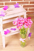 Composition with bouquet of tulips in vase, on ladder, on wall background — Foto de Stock