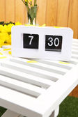Digital alarm clock on table, on wooden background — Stock Photo