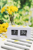 Digital alarm clock on table, on nature background — Stock Photo