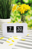 Digital alarm clock on table, on nature background — Stock Photo