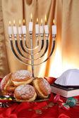 Feestelijke compositie voor hanukkah op doek close-up — Stockfoto