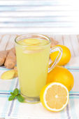 Healthy ginger tea with lemon and honey on table on light background — Stock Photo