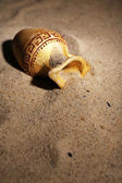 Greek ceramic amphora on sand, close up — Stock Photo
