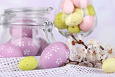 Composition with Easter eggs and blooming branches on light background — Foto Stock