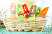 Funny handmade Easter rabbits in wicker basket — ストック写真