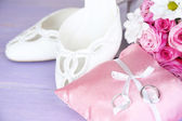 Beautiful wedding bouquet and shoes on wooden background — Stock Photo