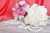Beautiful wedding bouquets on table on fabric background — Stock Photo