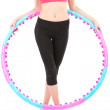 Woman doing exercises with hula hoop isolated on white — Stock Photo
