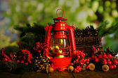 Red kerosene lamp on dark natural background — Stock Photo