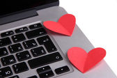 Red hearts on computer keyboard close up — Zdjęcie stockowe