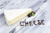 Tasty Italian cheese on wooden table — Stock Photo