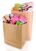 Presents in paper bags isolated on white — Stockfoto