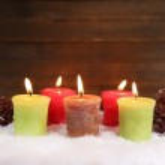 Burning candles on wooden background — Stock Photo #44560259