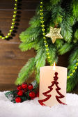 Burning candle on wooden background — Foto Stock
