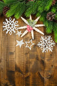 Beautiful snowflakes with fir branch on wooden background — Stock Photo