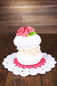 Tasty cake on table on wooden background — Stock Photo