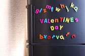 Colorful magnetic letters on  refrigerator — 图库照片