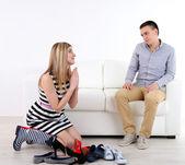 Loving couple choose new shoes, on light background — Photo