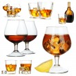 Collage of brandy glasses with ice cubes isolated on white — Stock Photo