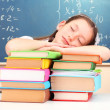 Little schoolgirl sleep in classroom near blackboard — Stock Photo #44737783