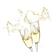 Glasses of champagne with splash, isolated on white — Stock Photo