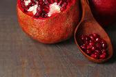 Ripe pomegranates on wooden background — Stock Photo