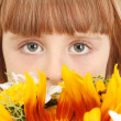 Portrait of beautiful little girl with flowers isolated on white — Stock Photo