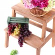 Wicker basket with flowers and fruits in wooden box,  on small wooden ladder, isolated on white — Stock Photo #44819715