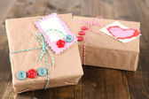 Paper gift boxes on wooden background — Stock fotografie
