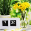 Digital alarm clock on table, on nature background — Stock Photo #44828377