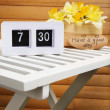 Digital alarm clock on table, on wooden background — Stock Photo #44828459