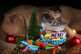Dreams written on color  rolled paper in glass jar, on sackcloth and fabric background — Stockfoto