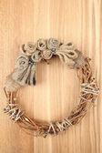 Beautiful rustic wreath, on wooden background — Stockfoto