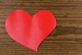 Paper hearts on wooden  background — Stock fotografie