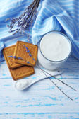 Homemade yogurt in glass and tasty cookie on wooden table background — Stock Photo