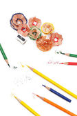 Colorful pencils and pencil shavings, isolated on white — Stok fotoğraf