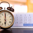 Alarm clock  and calendar on bright background — Stock Photo #44969751