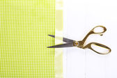Scissors on color fabric background — Stockfoto