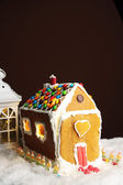 Gingerbread house on brown background — Stock Photo