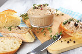 Fresh pate with bread on wooden table — Stock Photo