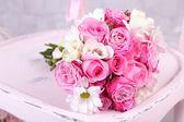 Beautiful wedding bouquet on wooden chair — Foto Stock