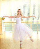 Beautiful balerina dancing in ballet class — Stock Photo