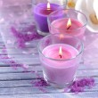 Beautiful colorful candles and  orchid flowers, on color wooden background — Stock Photo #45052721